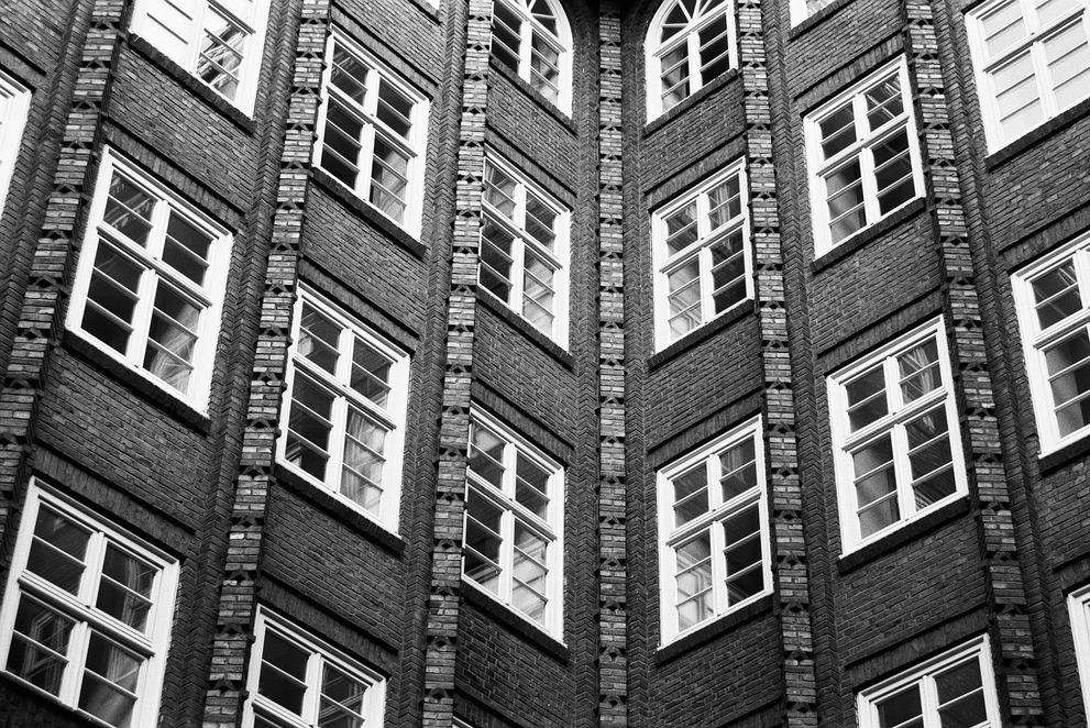 A black and white photograph of the windows of the Chilehaus in Hamburg.