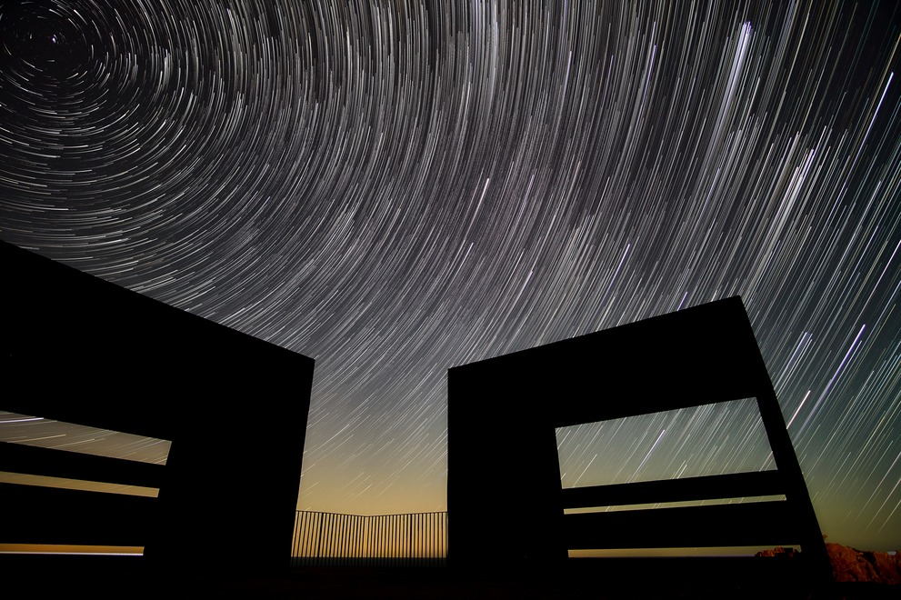 Star trails at the Cap de Creus with black quarters in the foreground